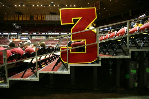 (AP Photo/Charlie Neibergall, File). FILE - In this Jan. 17, 2015, file photo, a large 3-point sign sits in the stands before an NCAA college basketball game between Iowa State and Kansas, in Ames, Iowa. The NCAA Playing Rules Oversight Panel announced...