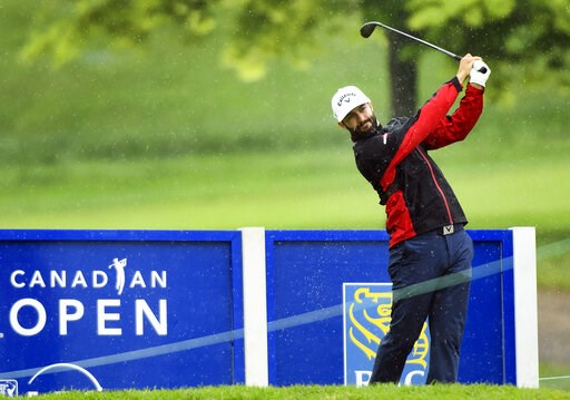 (Nathan Denette/The Canadian Press via AP). Canadian Adam Hadwin hits his tee shot on the 18th hole during the pro-am at the Canadian Open golf tournament, Wednesday, June 5, 2019, in Hamilton, Ontario.