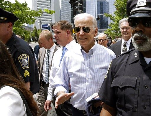 (AP Photo/Steven Senne). Former vice president and Democratic presidential candidate Joe Biden walks with Boston Mayor Marty Walsh, left, on Wednesday, June 5, 2019, in downtown Boston.
