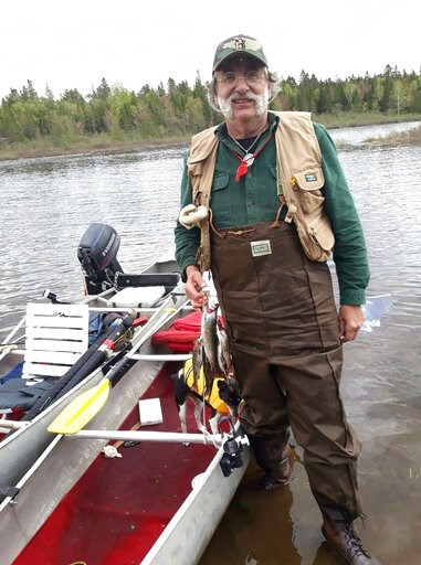 (AP Photo/Larry Fiori). Michael Fiori is seen with a pair of tandem canoes in the wilderness of northern Maine on Monday, June 4, 2019, just  hours before he and his brother Larry ended up in a fight for their lives when the canoes capsized in 50-degre...