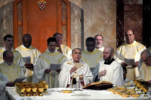 (AP Photo/David J. Phillip). Cardinal Daniel DiNardo presides over a Mass of Ordination for seven candidates for the priesthood at the Co-Cathedral of the Sacred Heart in Houston Saturday, June 1, 2019. DiNardo, leading the U.S. Catholic Church's sex a...