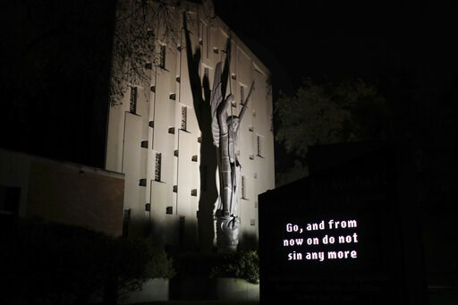 """(AP Photo/Wong Maye-E). An illuminated sign outside St. Michael Archangel Catholic Church in Houston reads, """"Go, and from now on do not sin any more"""" on April 11, 2019. The church, which has been grappling for decades with the sexual abuse of children,..."""