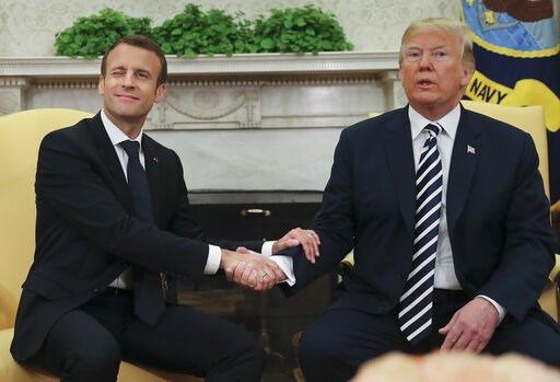 (AP Photo/Pablo Martinez Monsivais, File). FILE - In this April 24, 2018, file photo, French President Emmanuel Macron winks to members of the media during his meeting with President Donald Trump in the Oval Office at the White House in Washington. Tru...