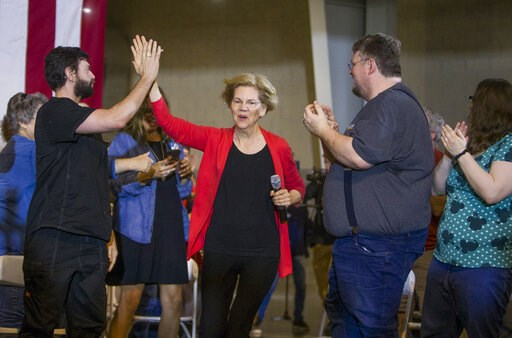 (Robert Franklin/South Bend Tribune via AP). Democratic presidential candidate Elizabeth Warren takes the stage for her Elkhart Community Conversation event on Wednesday, June 5, 2019, at the RV/MH Hall of Fame and Museum in Elkhart, Ind.