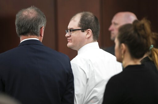 (Tracy Glantz/The State via AP). CORRECTS THE CITY TO LEXINGTON - Timothy Jones Jr. stands with his attorney Boyd Young at court in Lexington, S.C., Tuesday, June 4, 2019, after being found guilty in the deaths of his five children in 2014. A jury conv...