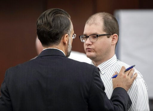 (Tracy Glantz/The State via AP, Pool). Defense attorney Casey Secor talks with Tim Jones during trial in Lexington, S.C. Timothy Jones, Jr.,  is accused of killing his five children in 2014. Jones, who faces the death penalty, has pleaded not guilty by...
