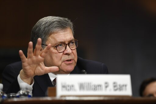 (AP Photo/Susan Walsh). FILE - In this May 1, 2019, file photo, Attorney General William Barr testifies before the Senate Judiciary Committee on Capitol Hill in Washington. Barr is defending his short summary of special counsel Robert Mueller's report ...