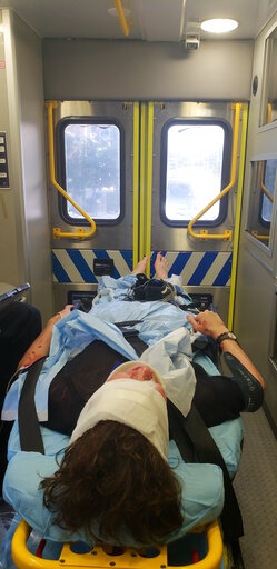 (Hope Lascurain via AP). In this Oct. 12, 2018, photo provided by Hope Lascurain, Drew Howerton takes an ambulance to the hospital after he fell off of a Lime scooter in Austin, Texas, and hit his head on the pavement. Howerton, a 19-year-old student s...
