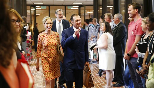 (Gary Cosby Jr./The Tuscaloosa News via AP). In this Sept. 20, 2018, photo, Hugh F. Culverhouse Jr. and his wife, Eliza, enter the University of Alabama law school in Tuscaloosa, Ala. The university appears poised to reject a $26.5 million pledge by Cu...