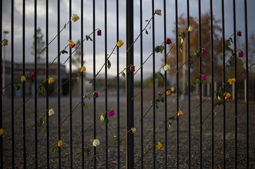 (AP Photo/Jae C. Hong, File). FILE - In this Dec. 11, 2015, file photo, roses adorn a makeshift memorial near the Inland Regional Center in San Bernardino, Calif. A radicalized couple carried out the attack on Dec. 2, against the husband's co-workers a...