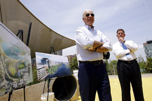 (AP Photo/Steven Senne). Former vice president and Democratic presidential candidate Joe Biden speaks on Wednesday, June 5, 2019, beside Boston Mayor Marty Walsh, right, and renderings of a park in being constructed in Boston in honor of Martin Richard...