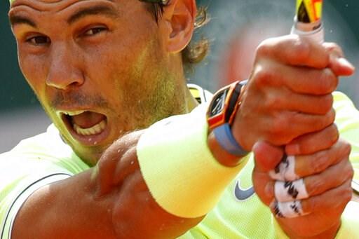 (AP Photo/Pavel Golovkin). Spain's Rafael Nadal plays a shot against Japan's Kei Nishikori during their quarterfinal match of the French Open tennis tournament at the Roland Garros stadium in Paris, Tuesday, June 4, 2019.