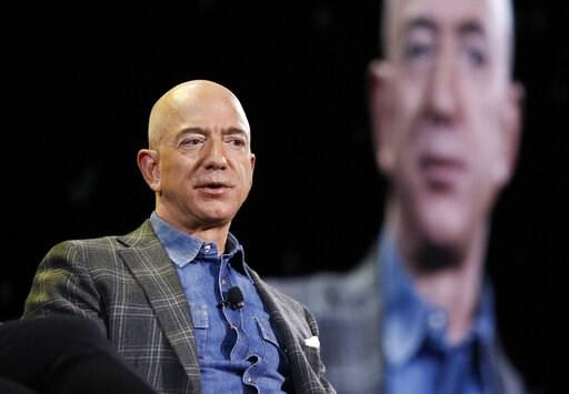 (AP Photo/John Locher). Amazon CEO Jeff Bezos speaks at the the Amazon re:MARS convention, Thursday, June 6, 2019, in Las Vegas.