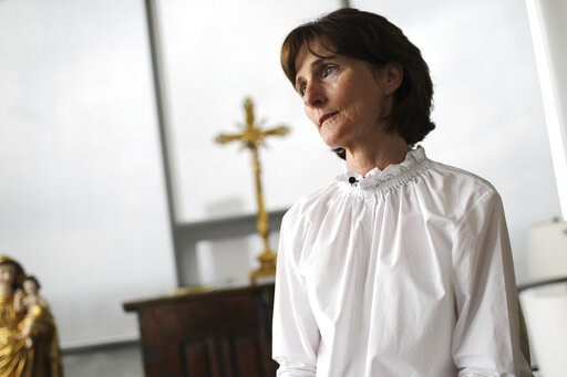 (AP Photo/Wong Maye-E). Laura Pontikes pauses during an interview in the prayer section of her apartment in Houston on April 13, 2019. The 55-year-old Texas construction company executive and mother of three had been seeking God when she began spiritua...