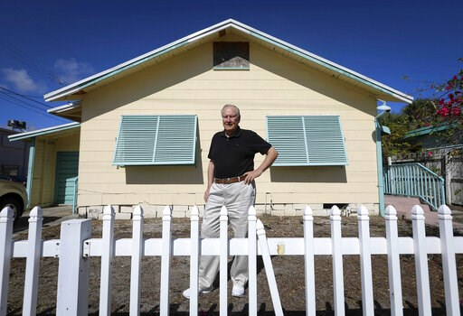 (Bruce R. Bennett/The Palm Beach Post via AP). In this Nov. 18, 2018, photo, Curtis Rogers, co-founder of GEDmatch, stands outside his office in Lake Worth, Fla. The popular online genetics database used to find unknown relatives has tightened its poli...