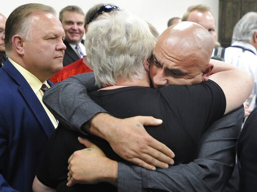 (Monte LaOrange/The Idaho Post-Register via AP). In this May 16, 2019 photo, Christopher Tapp hugs Carol Dodge at the conclusion of a press conference where the Idaho Falls Police announced that Brian Leigh Dripps had been arrested for the murder of Ca...