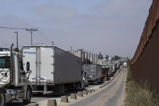(AP Photo/Hans-Maximo Musielik). Trucks line up to cross into the United States at the border in Tijuana, Mexico, Friday, June 7, 2019. Companies have been rushing to ship as many goods as possible out of Mexico to get ahead of possible tariffs threate...