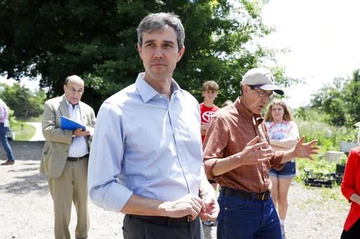 (AP Photo/Charlie Neibergall). Democratic presidential candidate Beto O'Rourke tours the Coyote Run Farm with farmer Matt Russell, right, Friday, June 7, 2019, in Lacona, Iowa.