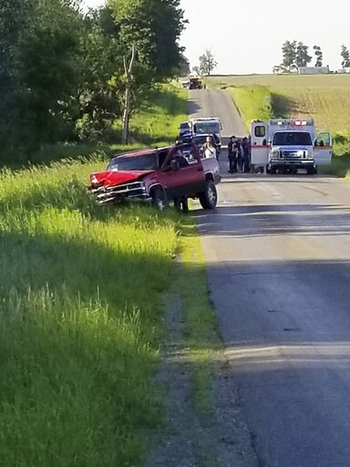 (Don Reid/The Daily Reporter via AP). A damaged truck sits on the side of the road after an accident involving a  horse-drawn carriage on Friday, June 7, 2019 in California Township, Mich.  Michigan State Police said the pick up truck was headed southb...