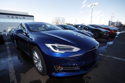 (AP Photo/David Zalubowski, File). FILE - In this Sunday, Feb. 3, 2019, file photograph, an unsold 2019 S75D sits at a Tesla dealership in Littleton, Colo. Rising trade tensions have sparked worries about the 17 exotic-sounding rare minerals needed for...