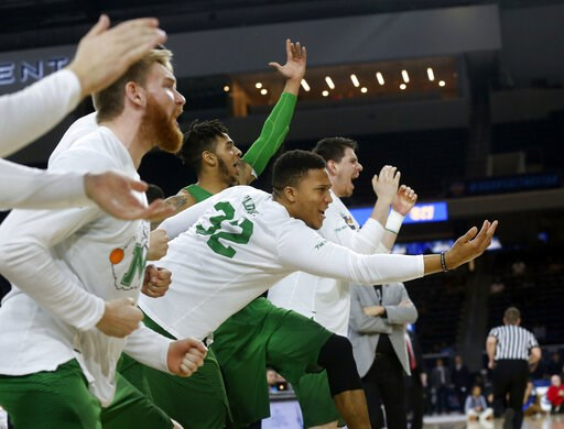 (AP Photo/Michael Ainsworth, File). FILE - In this Saturday, March 10, 2018, file photo, then-Marshall guard Phil Bledsoe (32) and the Marshall bench react to a 3-point shot against Western Kentucky during the second half of the NCAA Conference USA bas...