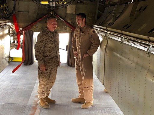 (AP Photo/Robert Burns). Marine Gen. Frank McKenzie, head of U.S. Central Command, confers with an Air Force officer below the bomb bay of a B-52 bomber on Friday, June 7, 2019 at al-Udeid air base in Qatar. McKenzie said on Friday that he thinks Iran ...