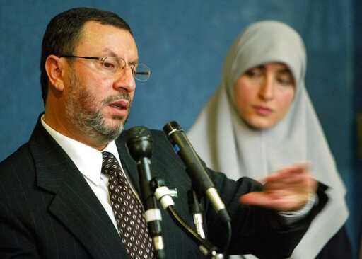 (AP Photo/Pablo Martinez Monsivais, File). FILE - In this Feb. 16, 2004 file photo,  Abdelhaleem Ashqar, left, with his wife Asma, right, meets reporters at the National Press Club in Washington, to announce his presidential candidacy for the Palestini...