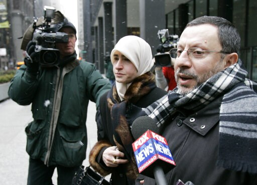 (AP Photo/Charles Rex Arbogast). FILE - In this Feb. 1, 2007 file photo, Abdelhaleem Ashqar is surrounded by cameramen as he leaves federal court with his wife, in Chicago. Ashquar who says he fears torture at the hands of Israeli authorities,  is back...