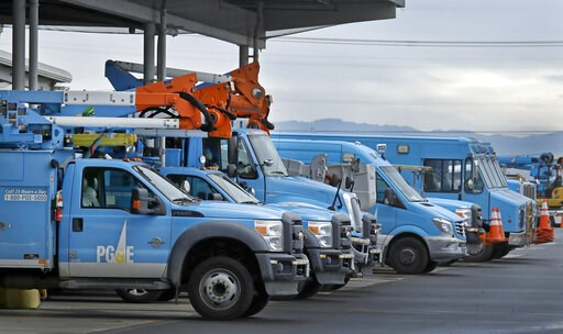 (AP Photo/Ben Margot, File). FILE - In this Jan. 14, 2019, file photo, Pacific Gas & Electric vehicles are parked at the PG&E Oakland Service Center in Oakland, Calif. The year's first fire danger warning in Northern California is putting Pacif...