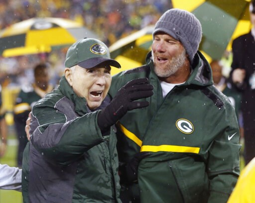 (AP Photo/Mike Roemer, File). FILE - In this Thursday, Nov. 26, 2015, file photo, Brett Favre, right, smiles at Bart Starr during a ceremony at halftime of an NFL football game between the Green Bay Packers and Chicago Bears in Green Bay, Wis. Starr, t...