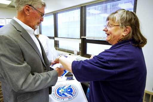 (AP Photo/Nati Harnik). In this April 25, 2019 photo, FEMA representative Kristina Pooler, right, talks to Ned Holmes, National Guard Employment Support specialist, about available FEMA jobs, at a job fair in Lincoln, Neb. With federal disaster recover...
