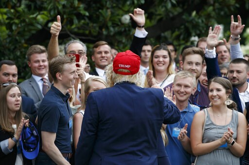 (AP Photo/Jacquelyn Martin). President Donald Trump greets supporters on his return to the White House, Friday June 7, 2019, in Washington.