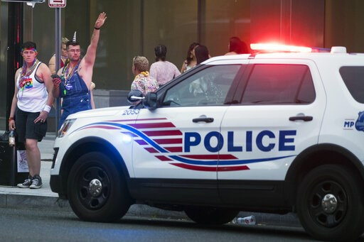 (AP Photo/Andrew Harnik). Police keep watch at Dupont Circle at the conclusion of the Capitol Pride Parade in Washington, Saturday, June 8, 2019. Officials in Washington say several people were injured after a panic at the LGBTQ pride parade sent peopl...
