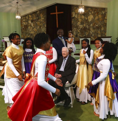 (Curtis Compton/Atlanta Journal-Constitution via AP). President Jimmy Carter has his picture taken with the Hayiya Dance Theatre, Inc. after they performed during the worship service at Maranatha Baptist Church on Sunday, June 9, 2019, in Plains, Ga. T...