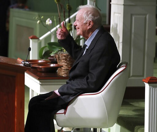 (Curtis Compton/Atlanta Journal-Constitution via AP). Former President Jimmy Carter smiles and gives the thumbs up as he returns to Maranatha Baptist Church to teach Sunday School on Sunday, June 9, 2019, less than a month after falling and breaking hi...