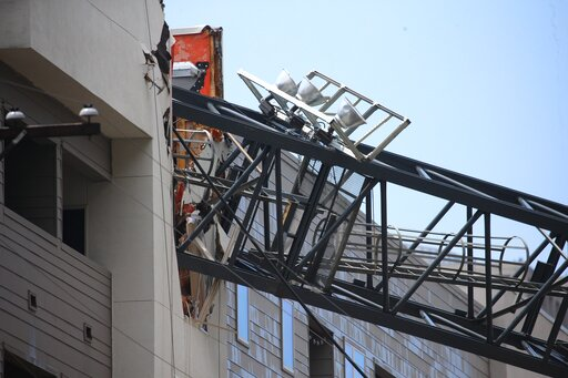 (Shaban Athuman/The Dallas Morning News via AP). Officials respond to the scene after a crane collapsed into Elan City Lights apartments amid severe thunderstorms, Sunday, June 9, 2019, in Dallas. Injuries were reported Sunday afternoon when storms pum...