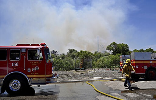 (AP Photo/Rick McClure). Los Angeles County firemen fight a brush fire burning close to Six Flags Magic Mountain and Hurricane Harbor amusement park in Santa Clarita, Calif., Sunday, June 9, 2019. Heavy smoke surrounding Six Flags Magic Mountain and Hu...