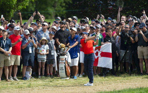 (Adrian Wyld/The Canadian Press via AP). Rory McIlroy of Northern Ireland hits an approach shot on the ninth hole during the final round of the Canadian Open golf championship in Ancaster, Ontario, on Sunday, June 9, 2019.