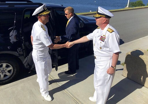 (AP Photo/Jennifer McDermott, File). FILE - In this June 12, 2018, file photo, Adm. John Richardson, left, chief of naval operations, greets Rear Adm. Jeffrey Harley, president of the U.S. Naval War College in Newport, R.I. Dozens of emails, which span...