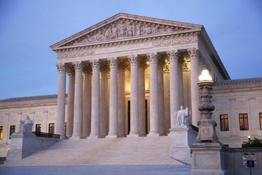(AP Photo/Patrick Semansky). In this May 23, 2019, photo, the U.S. Supreme Court building at dusk on Capitol Hill in Washington. The Supreme Court is rejecting a challenge to federal regulation of gun silencers, just days after a gunman used one in a s...