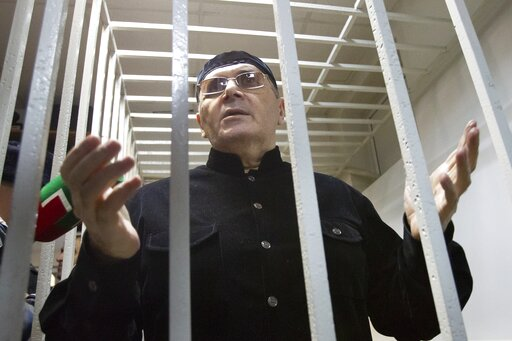 (AP Photo/Musa Sadulayev, File). FILE - In this Monday, March 18, 2019 file photo, Oyub Titiev, the head of a Chechnya branch of the prominent human rights group Memorial, gestures while standing behind bars in court after a hearing in Shali, Russia. A...