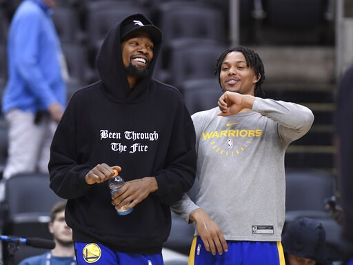 (Nathan Denette/The Canadian Press via AP). Golden State Warriors Kevin Durant, left, laughs with teammate Damion Lee during basketball practice at the NBA Finals in Toronto, Saturday, June 1, 2019.