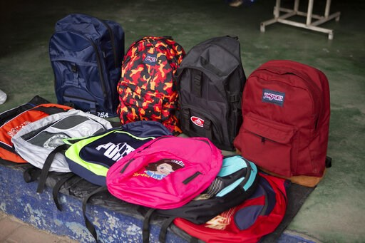 (AP Photo/Moises Castillo). In this June 8, 2019, photo, backpacks lie for sale inside a store at the bus terminal in San Marcos, Guatemala. The bus terminal is the place where many migrants in this area begin their journey in an attempt to reach the U...