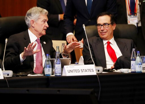 (Kim Kyung-hoon/Pool Photo via AP). Federal Reserve Chairman Jerome Powell talks with U.S. Treasury Secretary Steven Mnuchin during the G20 Finance Ministers and Central Bank Governors Meeting, Saturday, June 8, 2019, in Fukuoka, Japan.