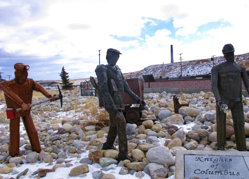 (AP Photo/Matt Volz, File). FILE - This Dec. 13, 2016, file photo, shows the former Anaconda smelter smokestack behind sculptures of miners at the Anaconda Smelter Stack State Park viewing area in Anaconda, Montana. Residents in the nearby community of...