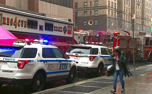 (WABC via AP). In this photo taken from video, first responders arrive near the scene where a helicopter was reported to have crash landed on top of a building in midtown Manhattan, Monday, June 10, 2019, in New York.