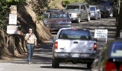 (Kent Porter/Press Democrat via AP, File). FILE - This July 17, 2015 file photo shows the entrance to the Bohemian Grove encampment in Monte Rio, Calif. A retreat for members of the elite Bohemian Club is facing renewed scrutiny for excluding women. Th...