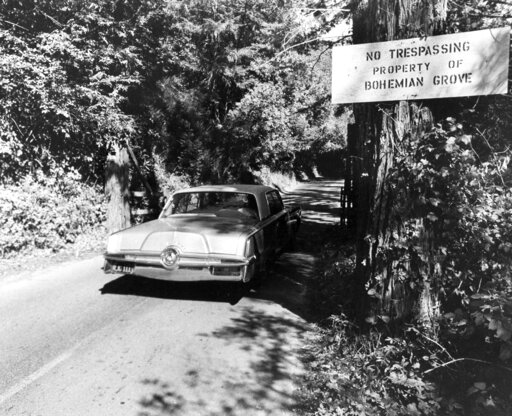 (AP Photo/Sal Veder, File). FILE - In this July 29, 1971 file photo is the roadway into the exclusive Bohemian Grove, a quiet encampment 80 miles north of San Francisco in Monte Rio, Calif. A retreat for members of the elite Bohemian Club is facing ren...