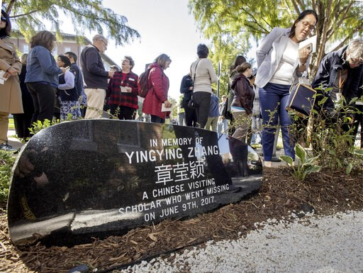 (Rick Danzl/The News-Gazette via AP). File-This Oct. 11, 2018, file photo shows guests mingling after a ceremony to dedicate the memorial garden for Yingying Zhang, Chinese scholar who disappeared from campus in June 2017. A judge at the trial of a for...