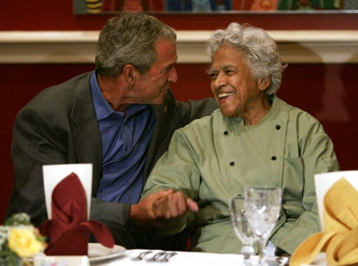 (AP Photo/Evan Vucci, File). FILE - In this Aug. 28, 2007 file photo, then President George W. Bush, left, talks with Leah Chase during a dinner with community leaders at her restaurant, Dooky Chase's, in New Orleans. Family, friends and admirers of Ch...